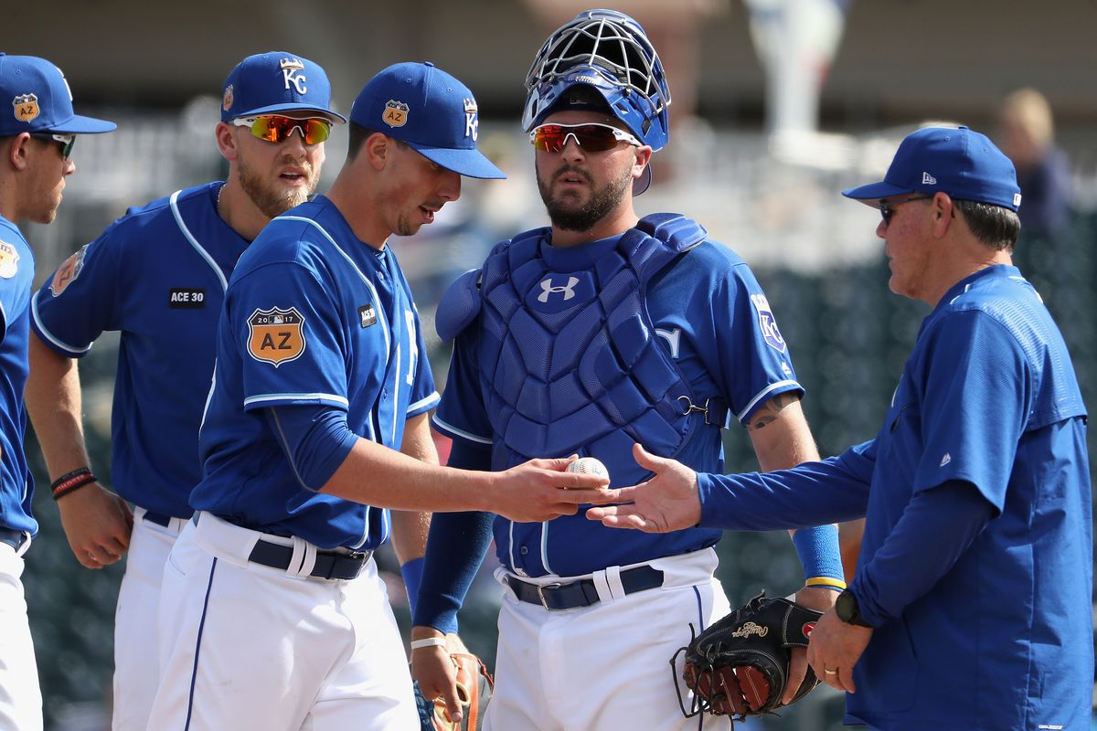 Starting pitcher Kyle Zimmer #45 of the Kansas City Royals is removed by manager Ned Yost #3 during the second inning of the spring training game against the Texas Rangers at Surprise Stadium on February 26, 2017 in Surprise, Arizona.