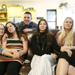 Jason and Heather Hansen, son Beau, daughter Anna, Amanda Pace and actress Tatum Chiniquy, center, watch a movie trailer at the Hansens' home in West Haven on Nov 20, 2016. The Hansens' daughter Kennedy died in June 2014 and is portrayed in a movie by Chiniquy.