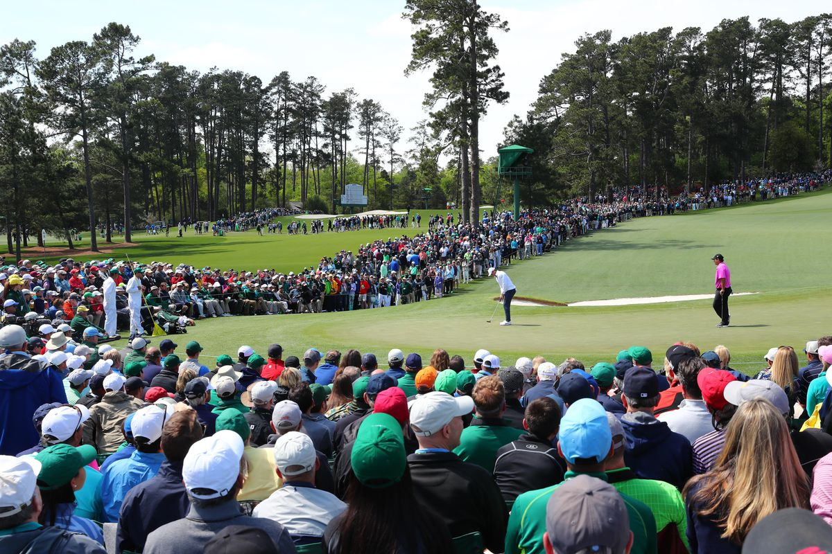 A general view of Rory McIlroy and Patrick Reed on the 2nd green during the final round of the Masters golf tournament at Augusta National Golf Club.