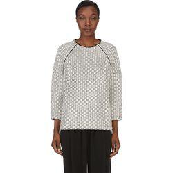 "<b>Studio Nicholson</b> sweater, <a href=""https://www.ssense.com/women/product/studio_nicholson/ivory-quilted-wool-neto-sweater/116605"">$156</a>"