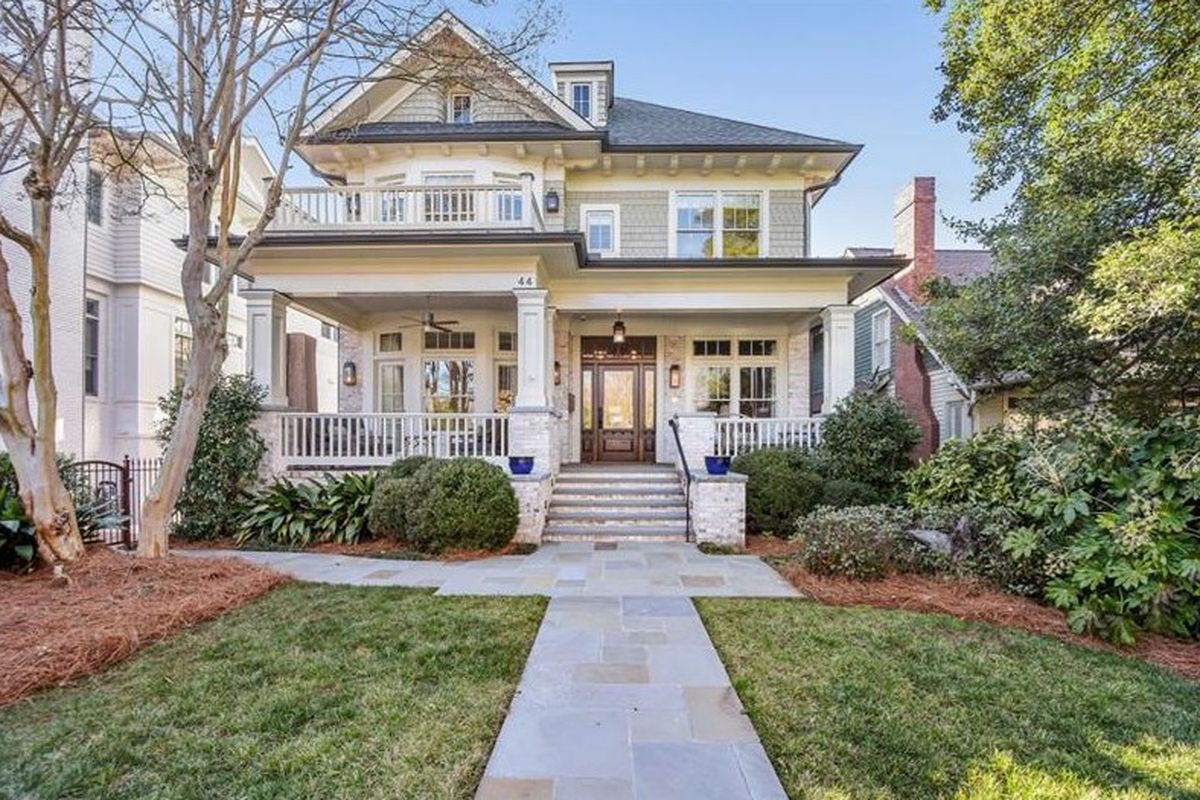 Two-story home with covered front porch.