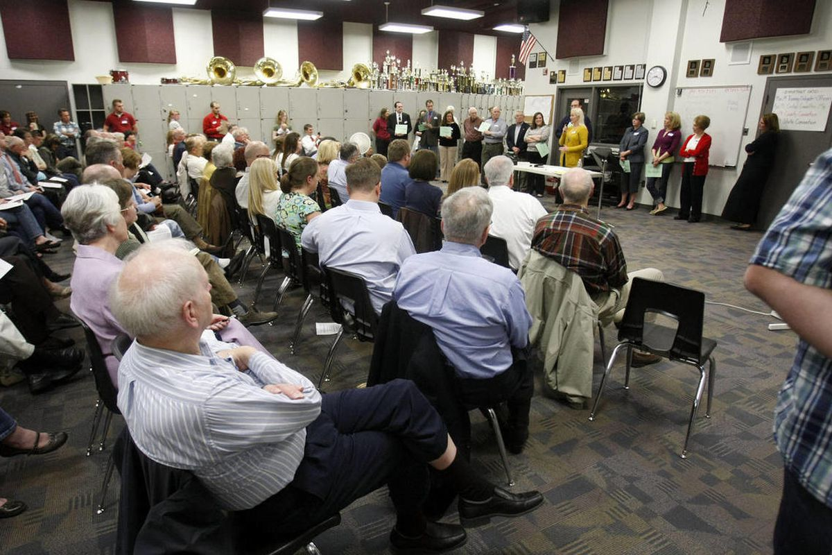 Residents attend the GOP Caucus meetings at Lone Peak High School in Highland. Thousands turned out at their Republican Party neighborhood caucus meetings around Utah, Thursday, March 15, 2012.