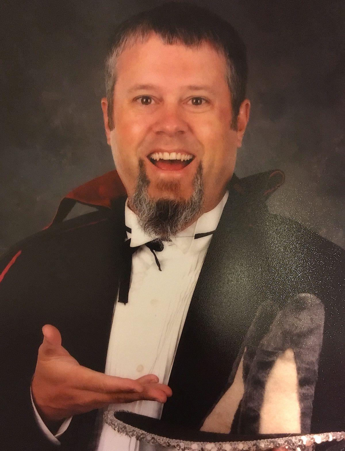 Music teacher Justin Bankey dressed as a magician