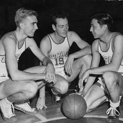 Arnie Ferrin (left) and Wat Misaka (right), shown here posing for a photo with a teammate, each spent time playing in the NBA after winning the NCAA tournament in 1944.