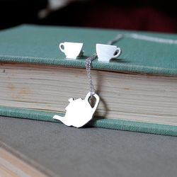 """Hand-cut sterling silver teacup and kettle jewelry set by <a href=""""http://www.etsy.com/shop/BathtubJungle?ref=seller_info"""">Bathtub Jungle</a>."""