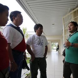 Bishop Joesph Giomena, right, talks with other members and leaders at the Sikatuna Chapel in Cebu Central LDS Stake, Saturday, Nov. 23, 2013.