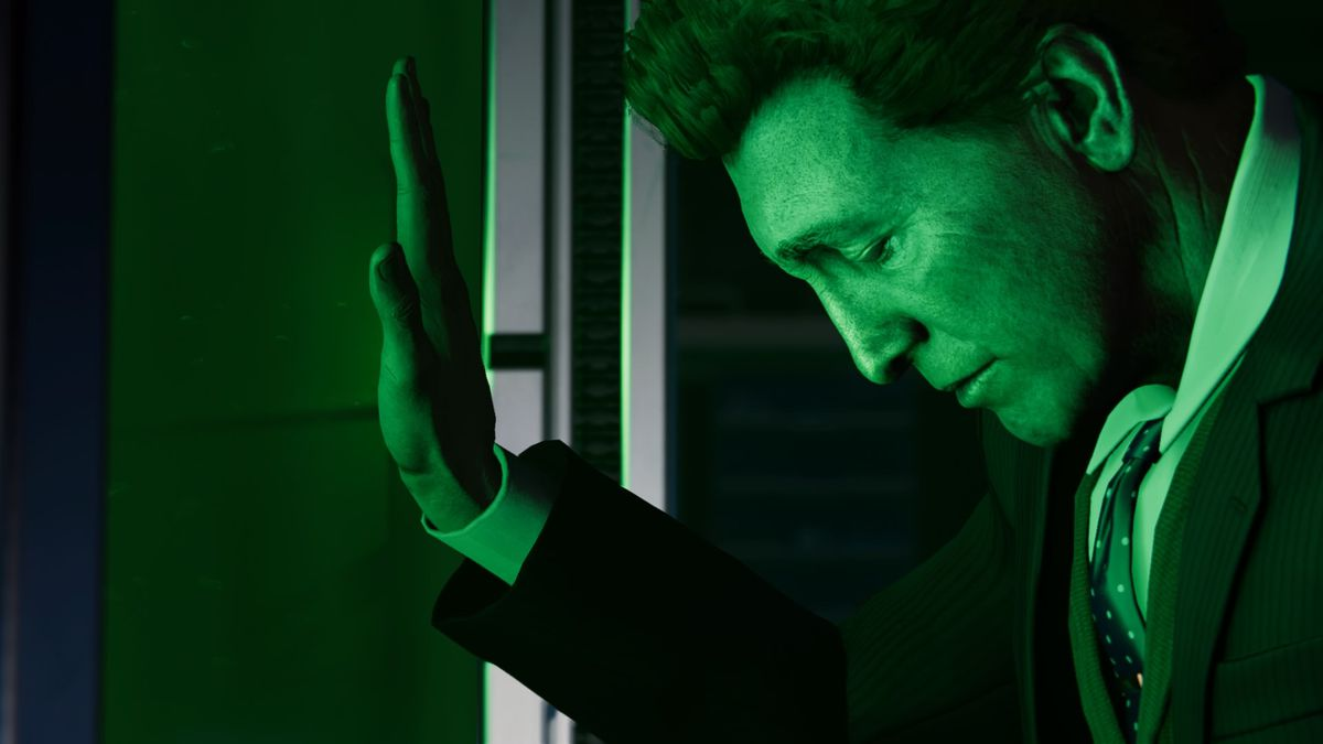 Spider Man: Norman Osborn leans against a glass pane, illuminated in green light.