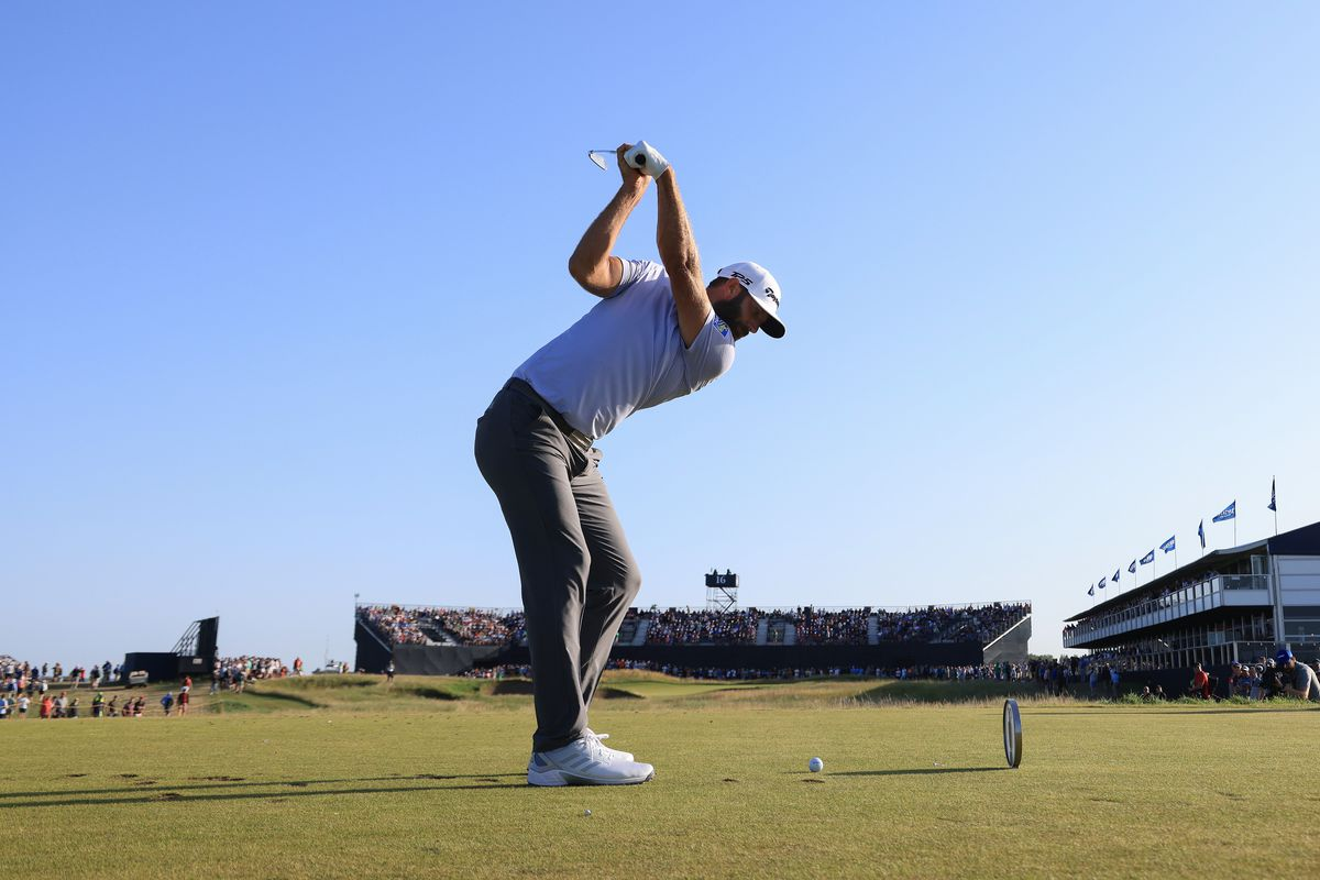 Dustin Johnson of the United States plays his shot from the 16th tee during Day Three of The 149th Open at Royal St George's Golf Club on July 17, 2021 in Sandwich, England.