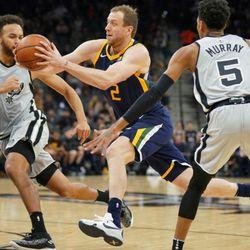Utah Jazz' Joe Ingles (2) drives between San Antonio Spurs' Kyle Anderson (1) and Dejounte Murray during the first half of an NBA basketball game, Saturday, Feb. 3, 2018, in San Antonio. (AP Photo/Darren Abate)