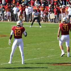 Cordarrius Bailey (18) and Conner Greene (31) also await the kick.