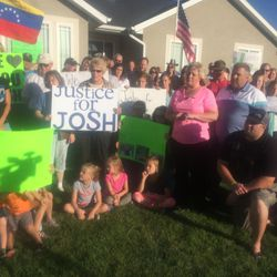 Josh Holt's parents stand in their front yard on Wednesday, Sept. 7, 2015, flanked by friends and neighbors, to make a plea for their son's release from police custody in Venezuela.