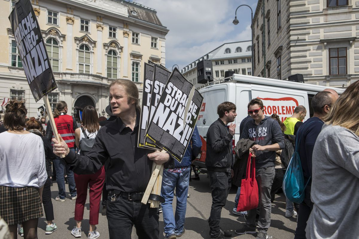 """People demonstrate outside the Federal Chancellery after former Austrian Vice-Chancellor Heinz-Christian Strache announced his resignation following the so-called """"Ibiza Affair"""" video on May 18, 2019 in Vienna, Austria."""