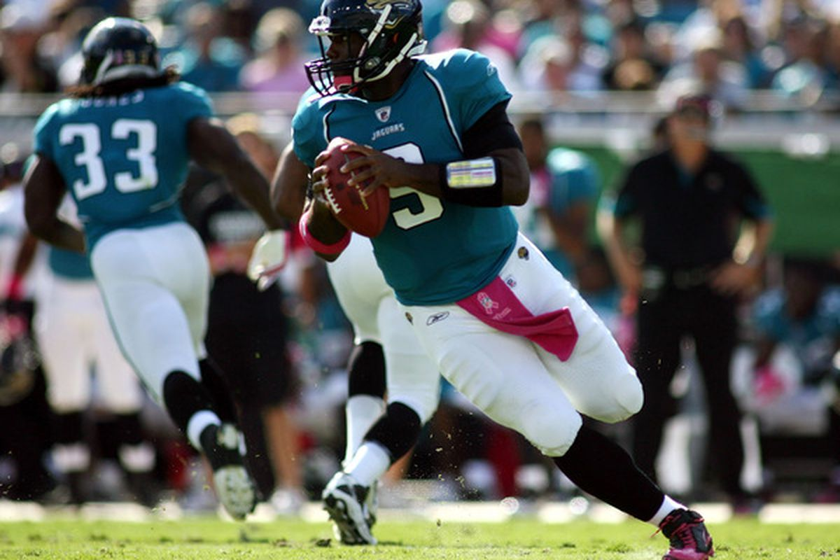 JACKSONVILLE FL - OCTOBER 03:  Quarterback David Garrard #9 of the Jacksonville Jaguars rolls out against the Indianapolis Colts at EverBank Field on October 3 2010 in Jacksonville Florida.  (Photo by Marc Serota/Getty Images)