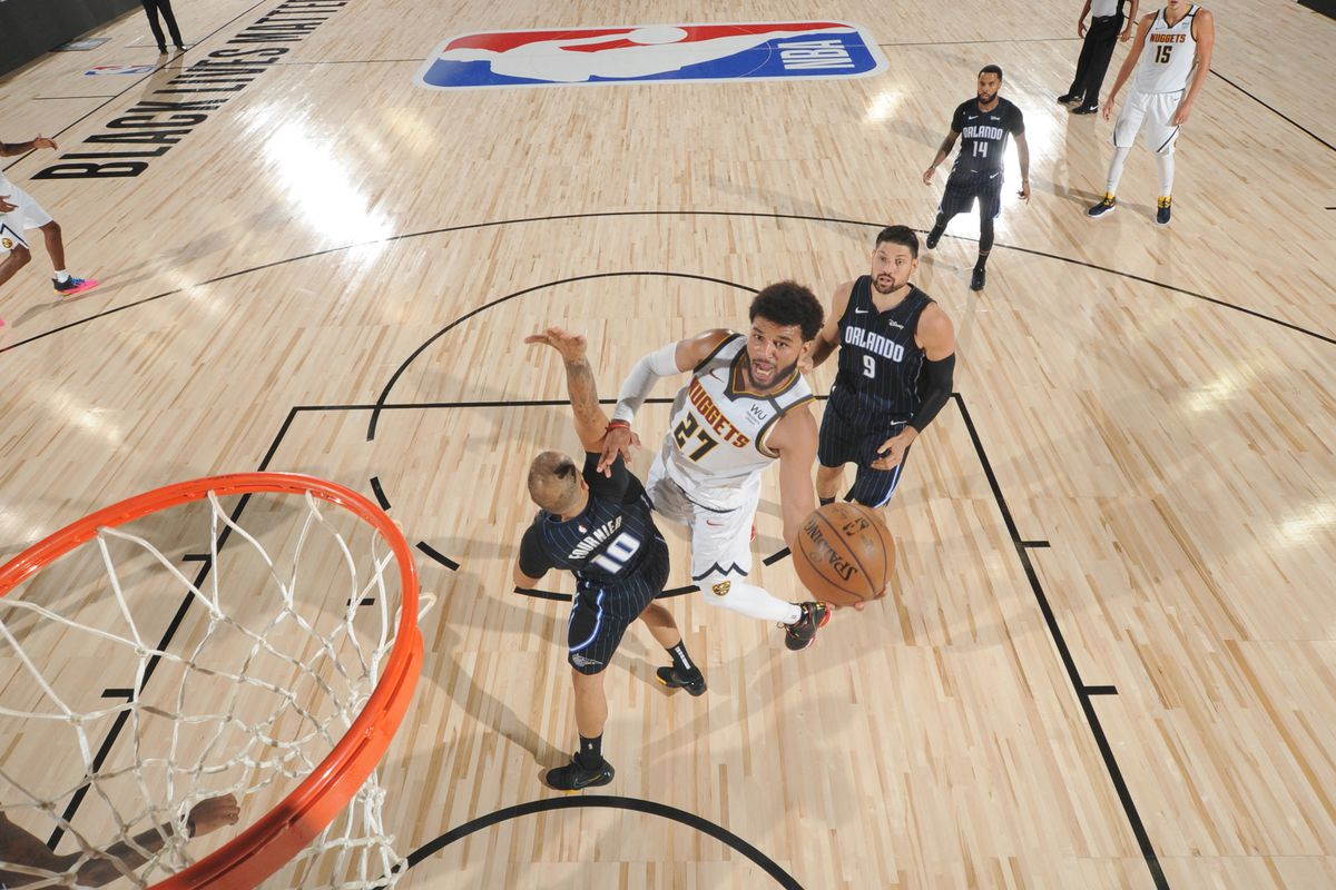 Jamal Murray of the Denver Nuggets shoots the ball against the Orlando Magic during a scrimmage on July 27, 2020 at The Arena at ESPN Wide World of Sports in Orlando, Florida.