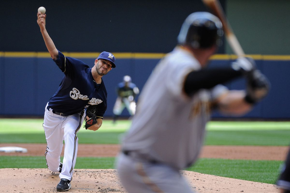June 3, 2012; Milwaukee, WI, USA;  Milwaukee Brewers pitcher Michael Fiers (64) pitches to Pittsburgh Pirates first baseman Casey McGehee (14) in the second inning at Miller Park.  Mandatory Credit: Benny Sieu-US PRESSWIRE