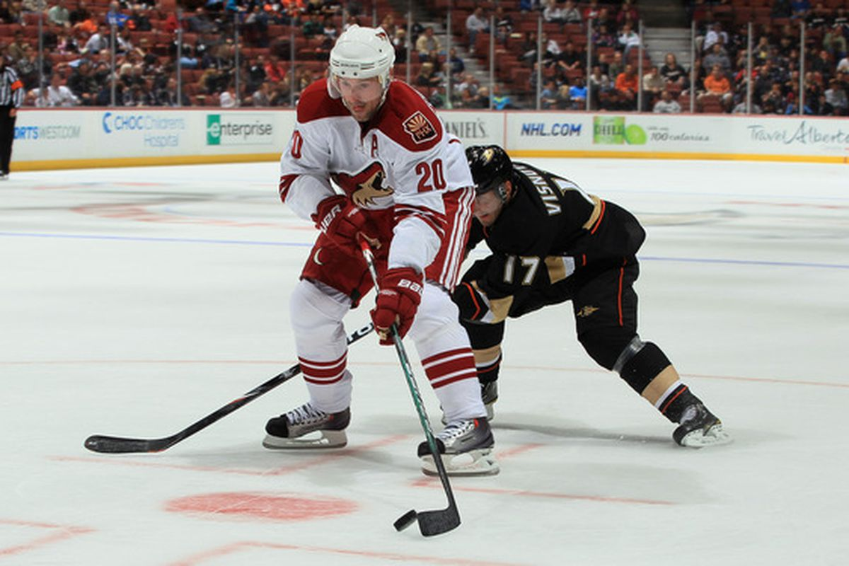 ANAHEIM CA - SEPTEMBER 21:  Eric Belanger #20 of the Phoenix Coyotes is pursued by Lubomir Visnovsky #17 of the Anaheim Ducks in the second period at Honda Center on September 21 2010 in Anaheim California.  (Photo by Jeff Gross/Getty Images)