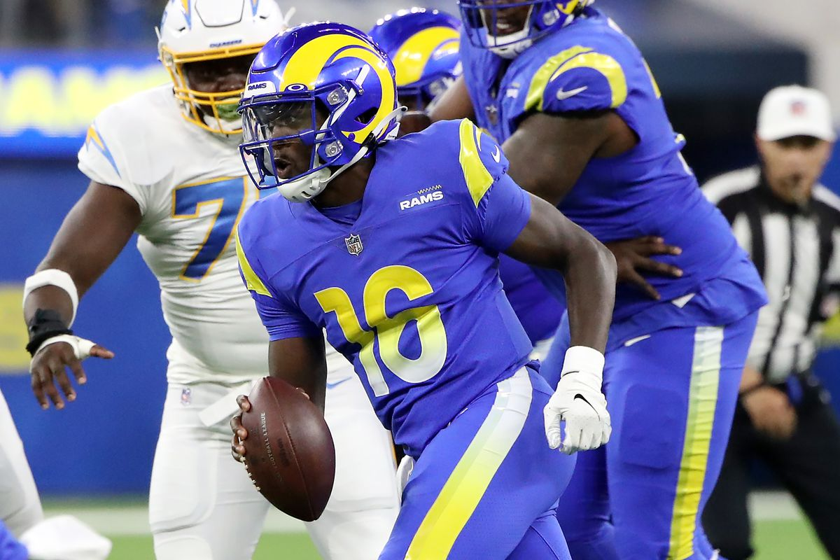 Bryce Perkins #16 of the Los Angeles Rams runs the ball against the Los Angeles Chargers during the second quarter during the preseason game at SoFi Stadium on August 14, 2021 in Inglewood, California.