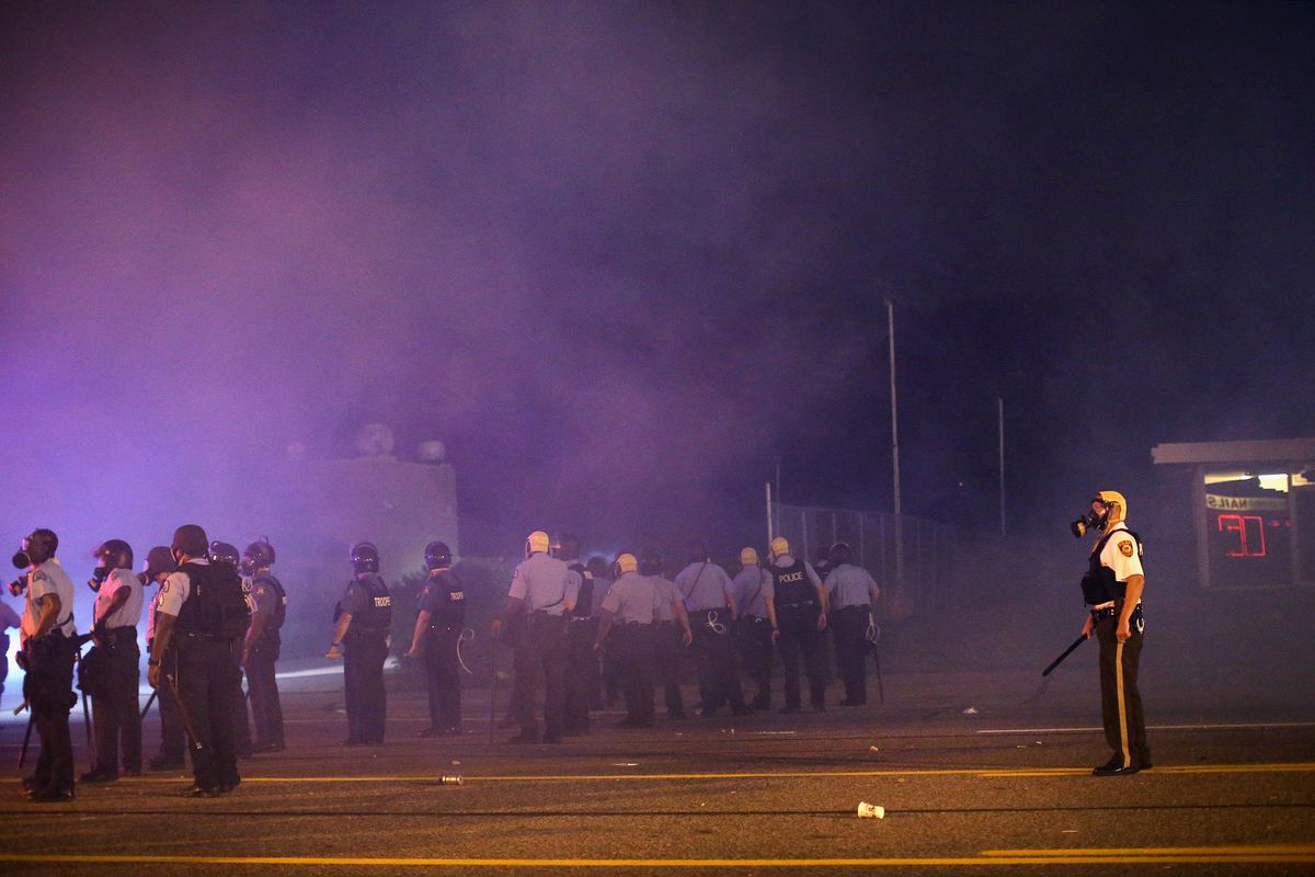 Police in Ferguson face off with protesters after deploying tear gas.