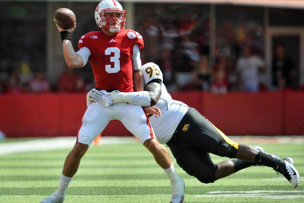 Nebraska's Taylor Martinez (3) Tries to get a pass off while being wrapped up by Southern Miss's Khalid Wilson (95) during an NCAA college football game, Saturday, Sept 1, 2012, in Lincoln, Neb.