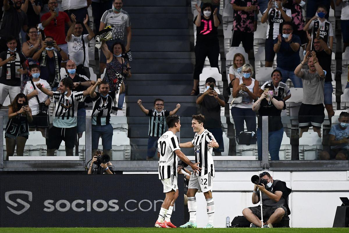 Paulo Dybala (L) of Juventus FC celebrates with Federico...