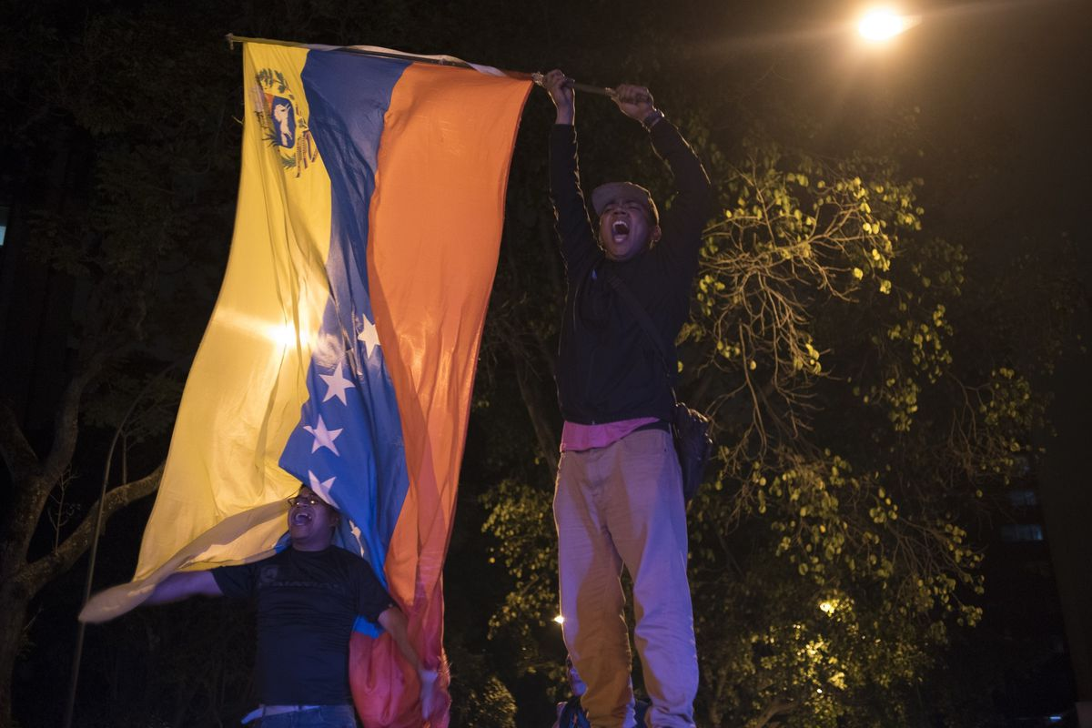 An opposition supporter celebrates the election results.