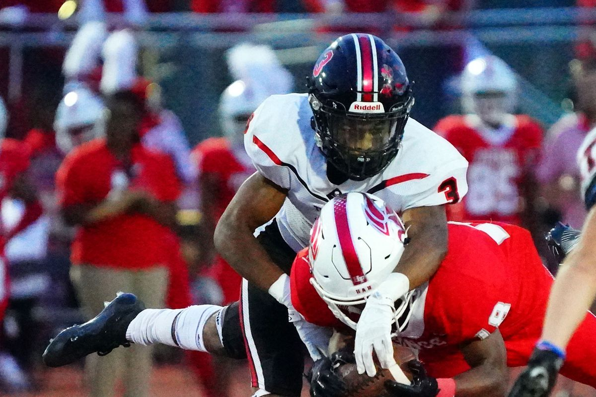 Bolingbrook's Damon Walters (3) forces an incompletion against Homewood-Flossmoor's Jeremiah Turner (18).
