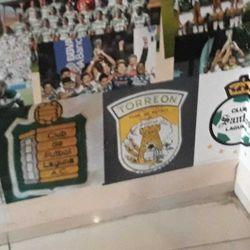 The crests of Club de Fútbol Laguna, Club de Fútbol Torreón, and Santos Laguna