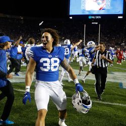 BYU players celebrate after winning an NCAA college football game against Utahat LaVell Edwards Stadium in Provo on Saturday, Sept. 11, 2021. BYU won 26-17.