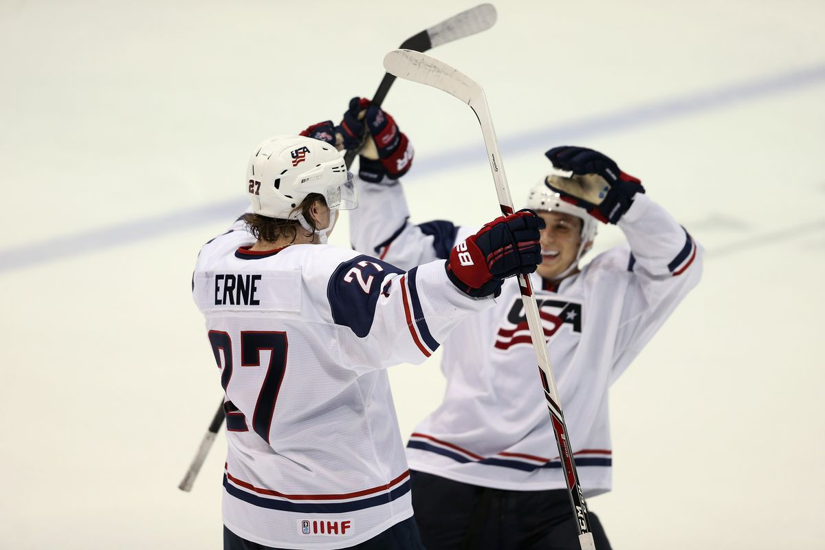 Adam Erne #27 of Team USA celebrates his game winning shoot out goal against Team Finland during the 2013 USA Hockey Junior Evaluation Camp August 8 in Lake Placid.