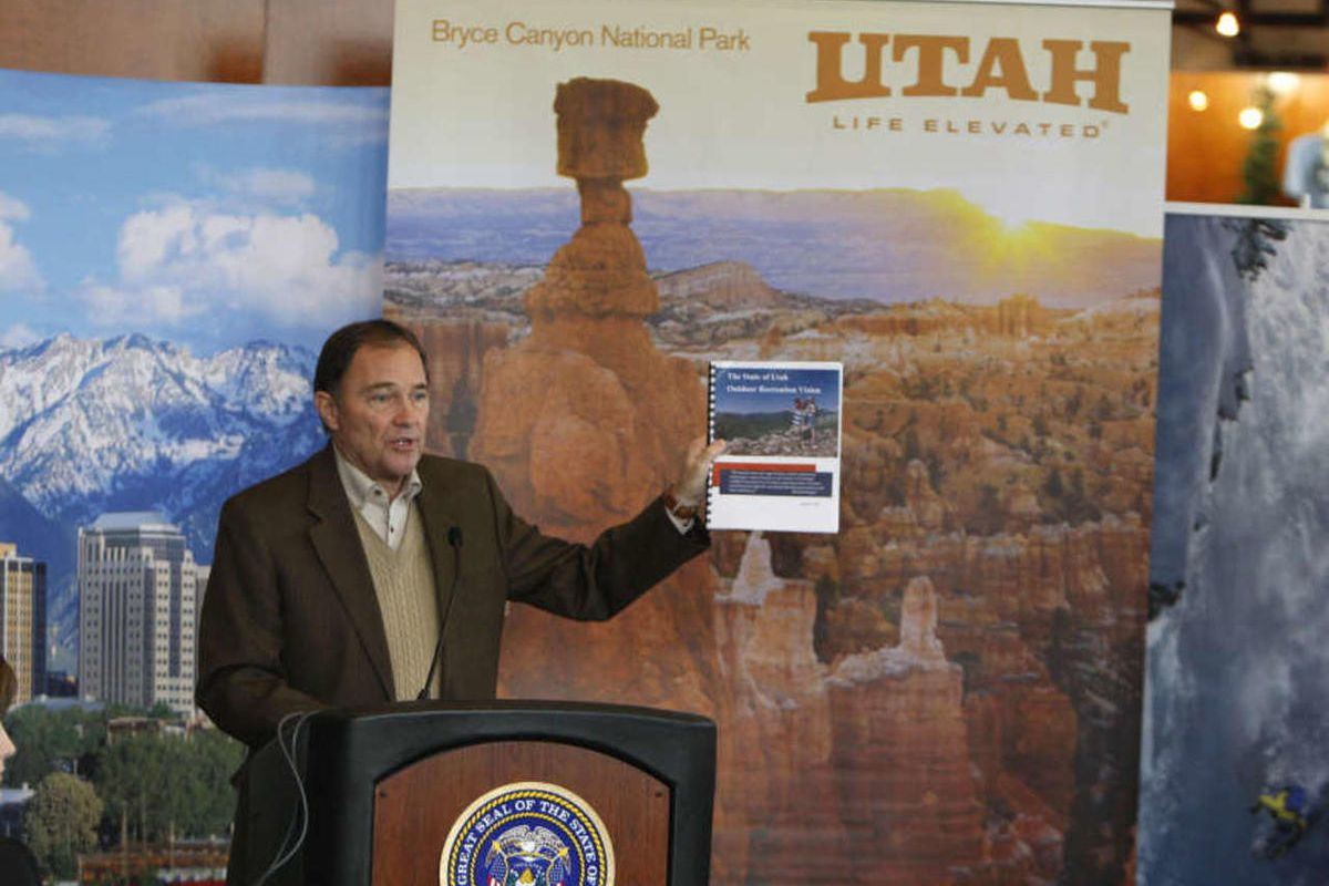 Governor Gary R. Herbert talks holds up The State of Utah Outdoor Recreation Vision report as he unveils the State of Utah's Outdoor Recreation Vision in collaboration with Outdoor Industry Association Wednesday, Jan. 23, 2013, in Salt Lake City.