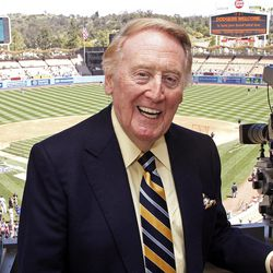 Veteran Los Angeles Dodgers broadcaster Vin Scully poses in the pressbox, his first game appearance since illness forced him to miss the first home games of the season, before a baseball game against the San Diego Padres in Los Angeles, Sunday, April 15, 2012.
