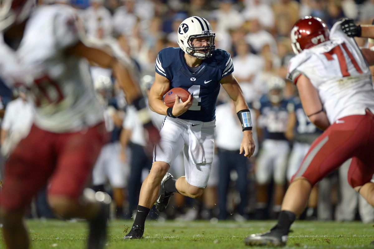 Aug 30, 2012; Provo, UT, USA; Brigham Young Cougars quarterback Taysom Hill (4) scrambles during the third quarter against the Washington State Cougars at Lavell Edwards Stadium. Mandatory Credit: Jake Roth-US PRESSWIRE