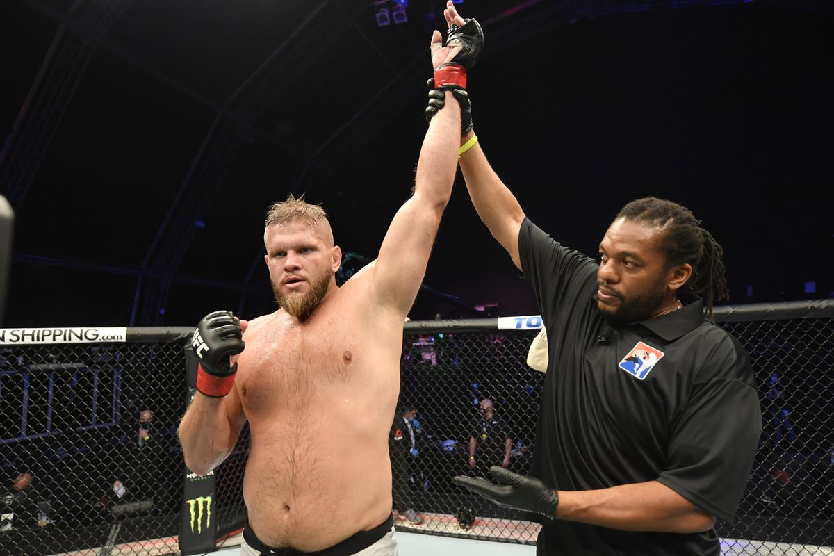 Marcin Tybura of Poland celebrates after defeating Maxim Grishin in their heavyweight fight during the UFC 251 event at Flash Forum on UFC Fight Island on July 12, 2020 on Yas Island, Abu Dhabi, United Arab Emirates.