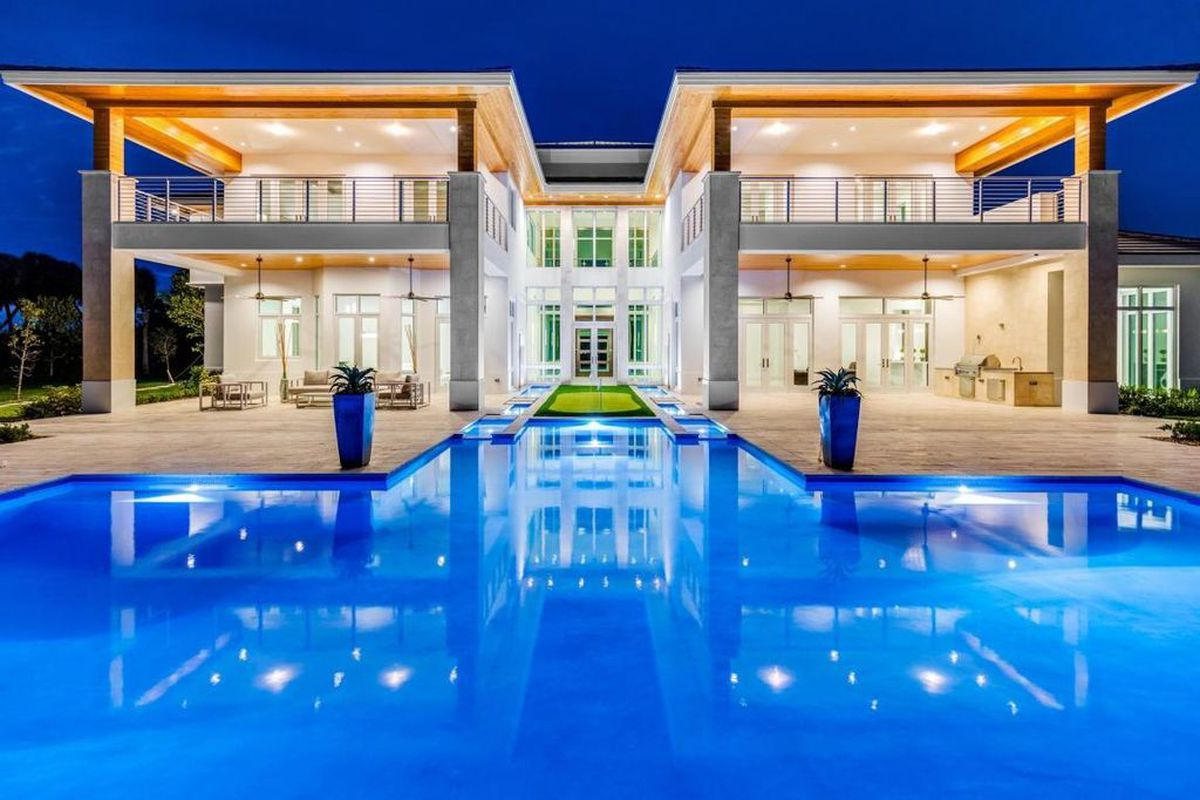 new construction in delray beach with poolside putting green asks