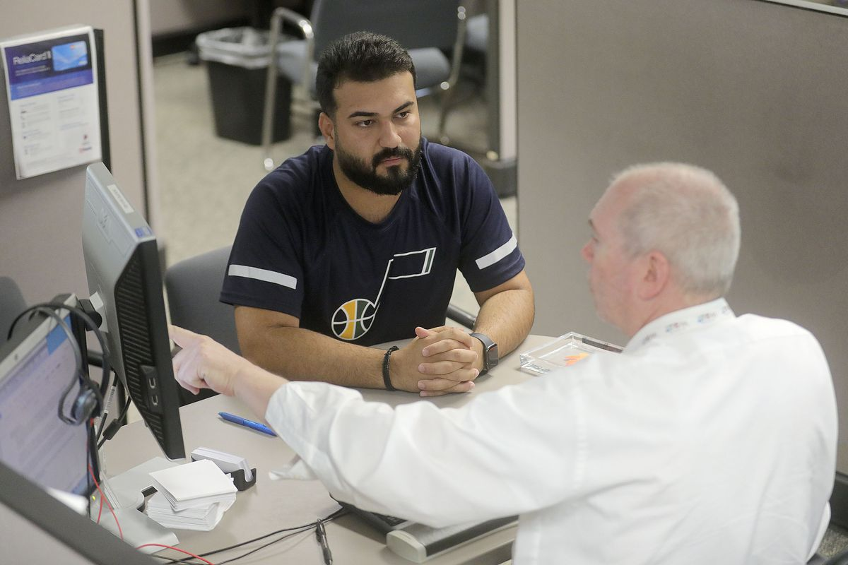 Omar Shukur meets with B.BK Keown, an employment counselor with the UtahDepartment of Workforce Services, during an initial assessment meeting at the department's offices in Salt Lake City on Tuesday, June 22, 2021.