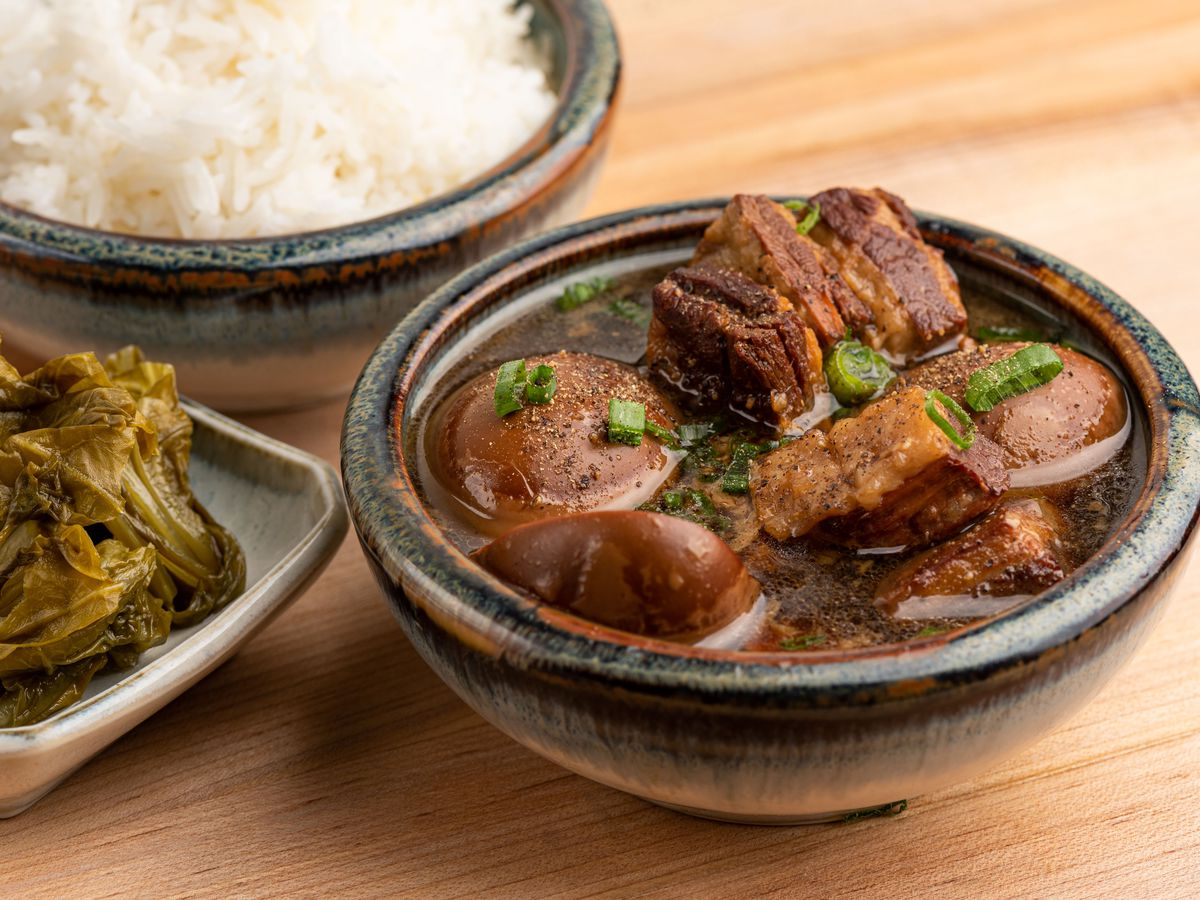 Caramelized pork and eggs with pickled mustard greens and steamed rice.