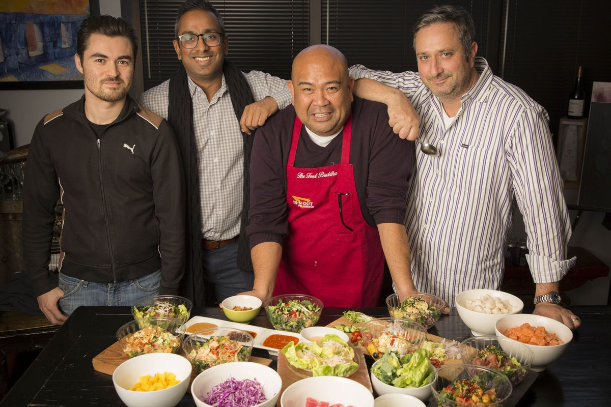 Rodelio Aglibot (center) and the FireFin Poké Shop crew.