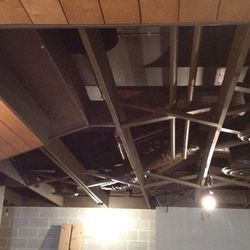 Exposed vents and duct work run throughout the space