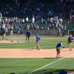 4:05 p.m. Grounds crew already at work -