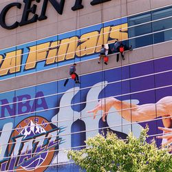 Workers ready the Delta Center in preparation for Game 1 of the NBA Finals on June 1, 1998.