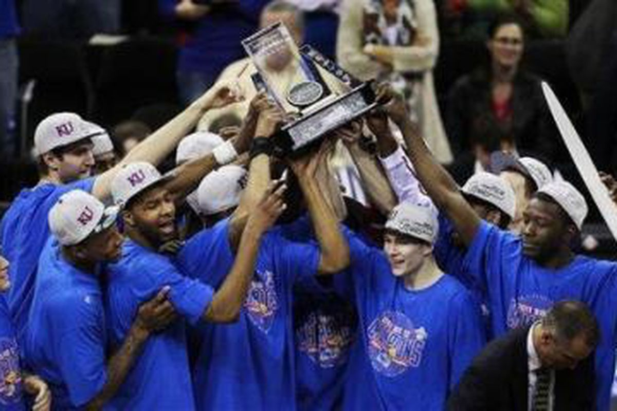 The Kansas Jayhawks celebrate winning the Big 12 Championship after defeating Texas in the championship game.