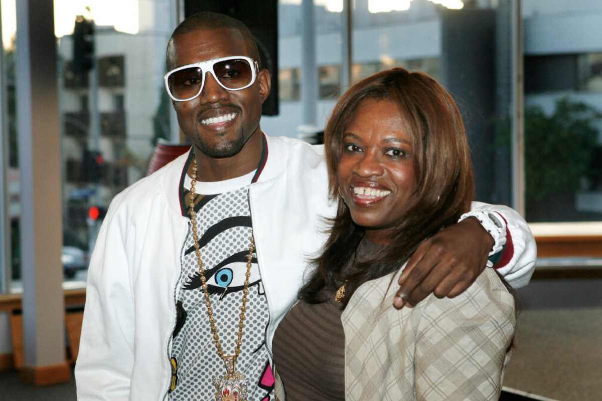 Donda West and her son, Kanye, attend a book signing for her book in 2007 in Los Angeles.