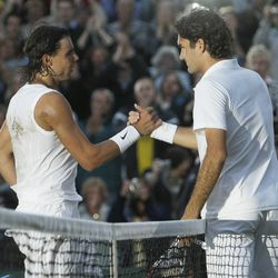 In this July 6, 2008 file photo Spain's Rafael Nadal left, shakes the hand of Switzerland's Roger Federer after winning the men's final on the Centre Court at Wimbledon.