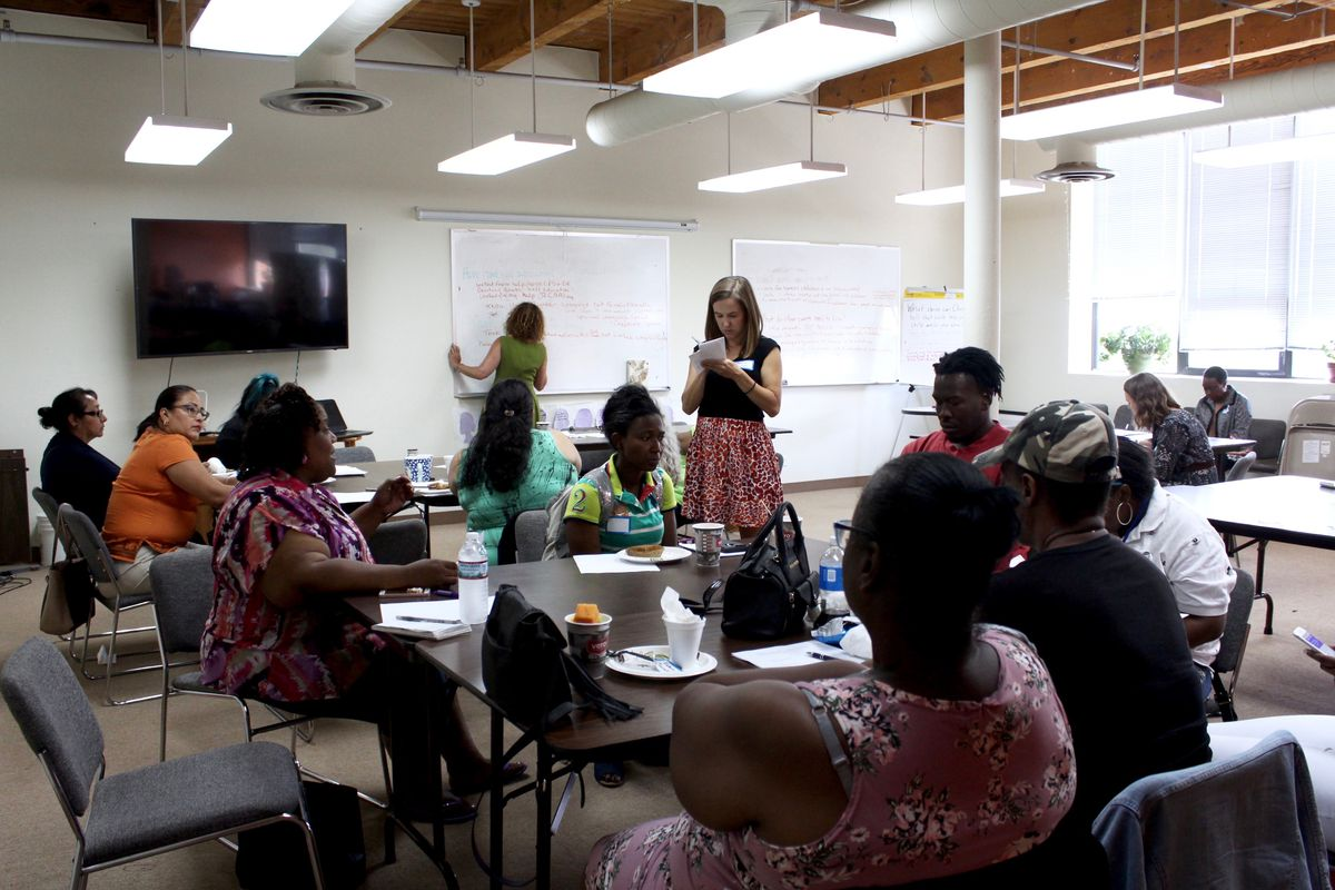 Parent members of Community Organizing and Family Issues in Chicago discuss on July 31, 2018, how to advocate for their special-needs children.