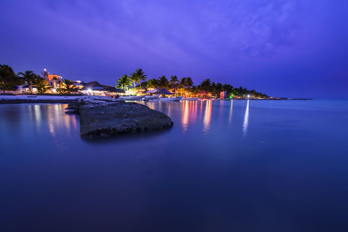 Dock in a beach of Isla Holbox at sunset, Quintana Roo, Mexico.