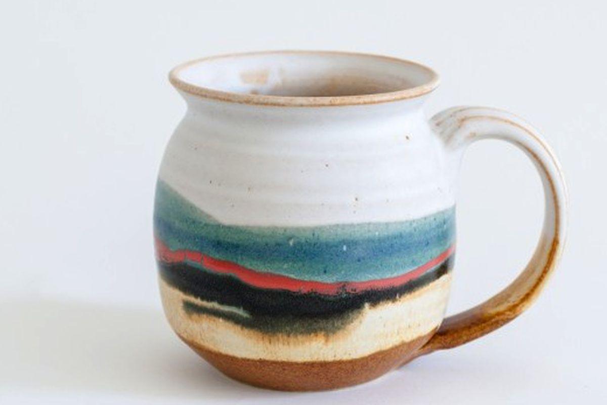 """Robert Blue 14 ounce mug, <a href=""""http://store.mociun.com/home-products/ceramics/#!/452-14-ounce-mug/"""">$28</a>"""