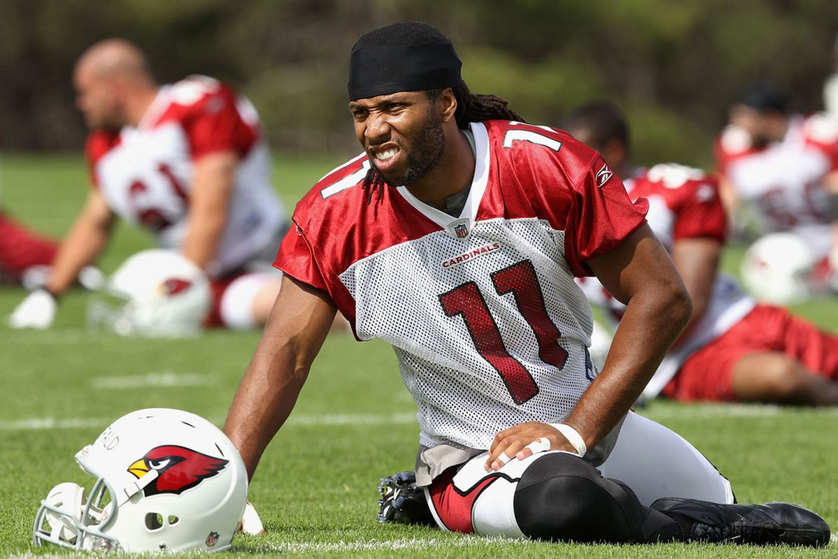 FLAGSTAFF, AZ - JULY 30:  Wide receiver Larry Fitzgerald #11 of the Arizona Cardinals warms up during the team training camp at Northern Arizona University on July 30, 2011 in Flagstaff, Arizona.  (Photo by Christian Petersen/Getty Images)