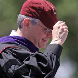 Supreme Court nominee Merrick Garland adjusts his baseball cap as he speaks at Niles West's 2016 commencement ceremony Sunday in Skokie.   Tim Boyle/For the Sun-Times