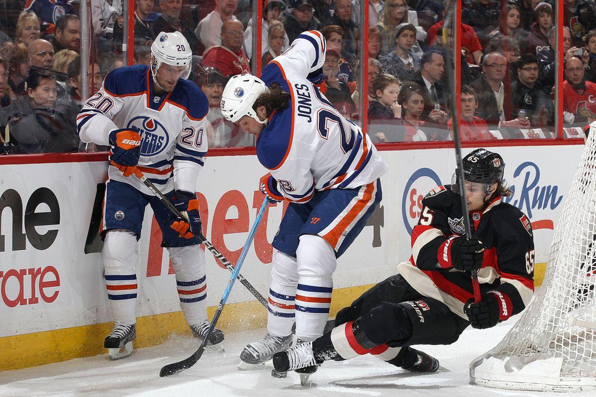 Erik Karlsson tries to sweep the leg as he prepares to put Ryan Jones in the Sharp Shooter.