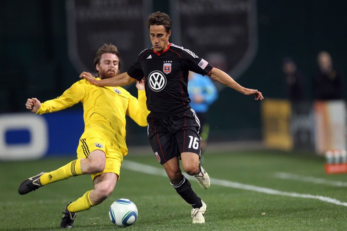 WASHINGTON, D.C. - MARCH 19: Josh Wolff #16 of D.C. United controls the ball against Eddie Gaven #12 of the Columbus Crew at RFK Stadium on March 19, 2011 in Washington, DC. (Photo by Ned Dishman/Getty Images)